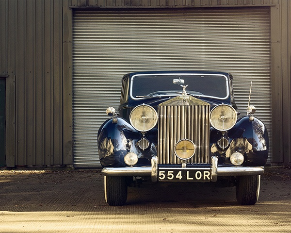 Beautiful antique car in front of a car storage unit